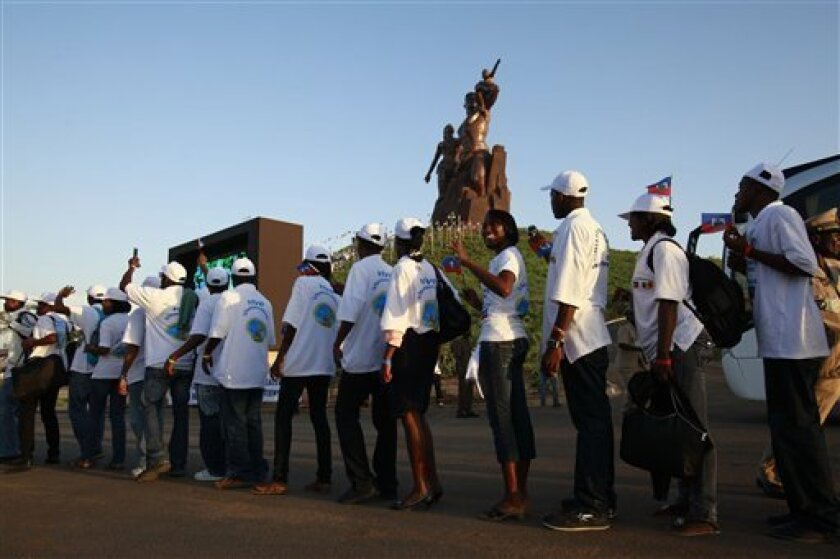 Haitian students arrive at the controversial African Renaissance Monument for a ceremony welcoming them to Dakar, Senegal Wednesday, Oct. 13, 2010. Senegal is one of the poorest countries in the world and its GDP is only marginally higher than Haiti's, but that didn't stop the government from going