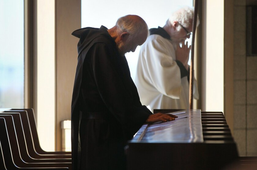 Brother Blaise Heuke, a Benedictine monk at Oceanside's Prince of Peace Abbey, prays during a morning service there.
