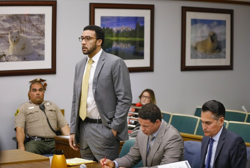 Ex-NFL player Kellen Winslow II, standing, who was accused of committing several sex crimes against women in North County last year, including rape answers a question from Vista Superior Court Judge Blaine Bowman on Friday in Vista, during a status hearing. Winslow will be retried this fall on the eight counts that the jury in his first trial deadlocked on earlier this week