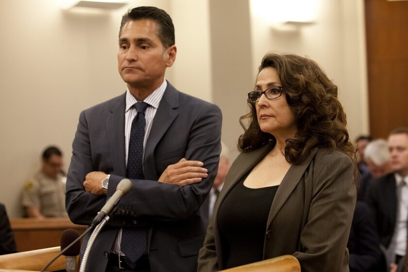 Sweetwater school board member Pearl Quiñones with her attorney Marc Carlos appeared for her arraignment before Judge Ana Espana in the South Bay Superior Court in Chula Vista on April 12.