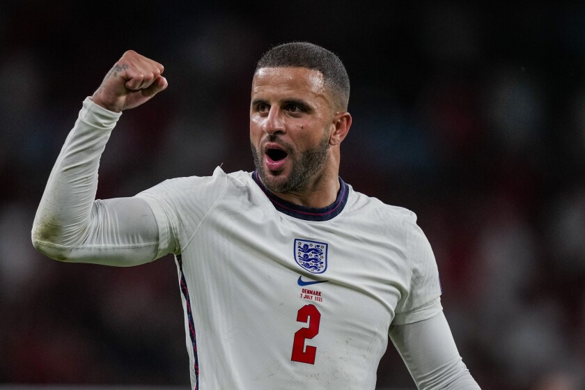 England's Kyle Walker celebrates after winning the Euro 2020 soccer championship semifinal match against Denmark at Wembley stadium in London, Wednesday, July 7, 2021. (AP Photo/Frank Augstein, Pool)