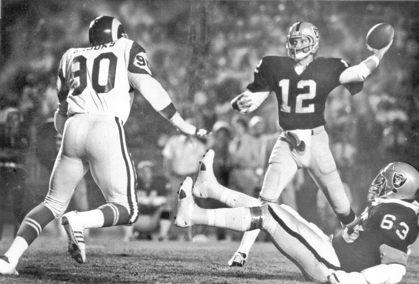 Oakland Raiders quarterback Ken Stabler gets off a pass against the Los Angeles Rams in a 1977 game. Stabler died in his native Alabama at the age of 69.