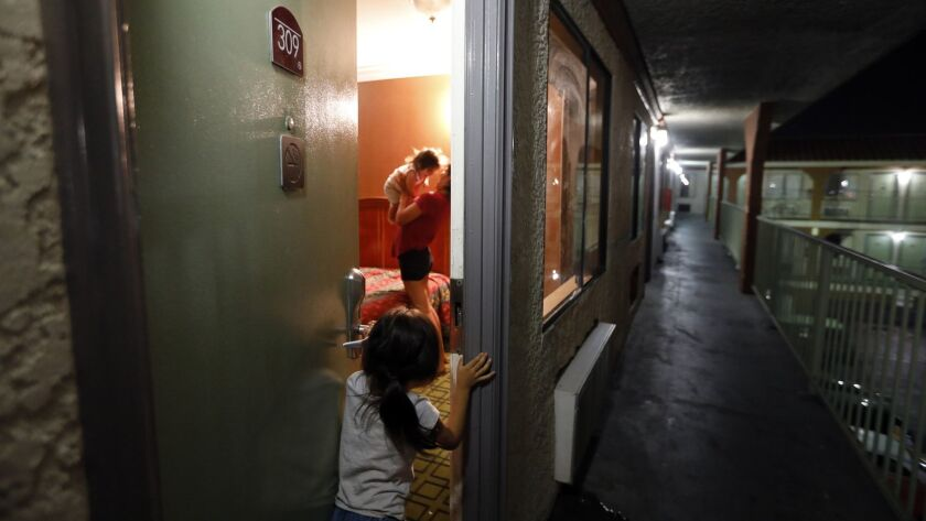 NORTH HILLS, CA September 27, 2018: Madelyn, 5, peeks into the motel room where her family is stay