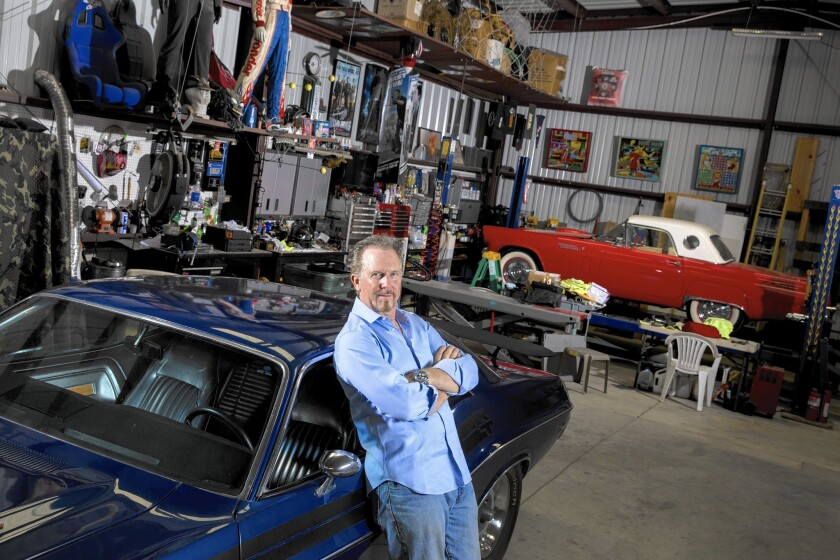 Veteran stuntman Jack Gill inside his workshop, with his 1971 Dodge Challenger RT and an assortment of collectibles from various film and TV projects, in Agoura Hills, Calif., on June 16, 2015.