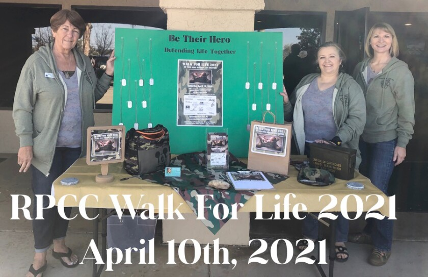 Ramona Pregnancy Care Clinic prepares for Walk for Life with, from left, Anita Krisik, Sophie O'Connor and Becky Strahm.