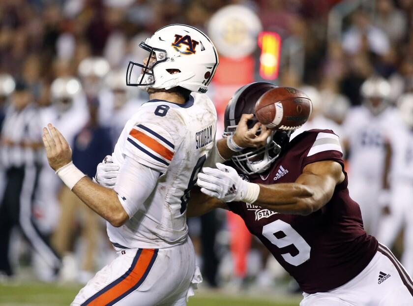 Mississippi State defensive end Montez Sweat forces Auburn quarterback Jarrett Stidham to fumble.