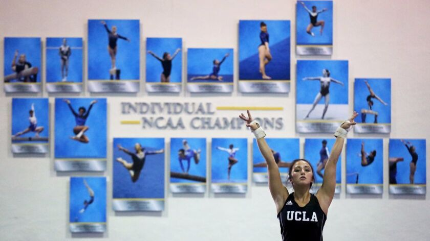 Angi Cipra puts her arms up as she visualizes her floor routine during practice at UCLA.