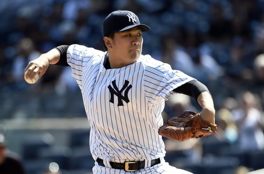 FILE - In this Sept. 13, 2015, file photo, New York Yankees starter Masahiro Tanaka pitches in the first inning of a baseball game against the Toronto Blue Jays in New York. As Tanaka enters his third season in the major leagues, the Yankees ace can communicate with his teammates in English. (AP Photo/Kathy Kmonicek, File)
