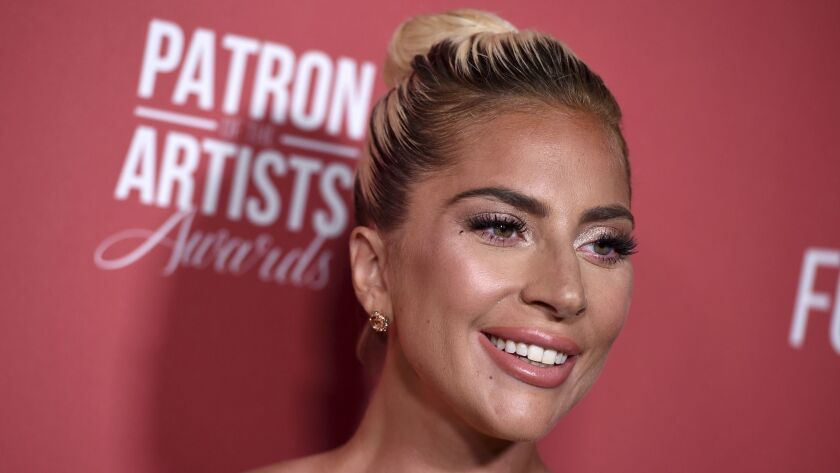 Lady Gaga arrives at the Patron of the Artists Awards on Nov. 8. On Tuesday, she visited wildfire evacuation centers around Los Angeles bearing pizza, coffee and comfort.