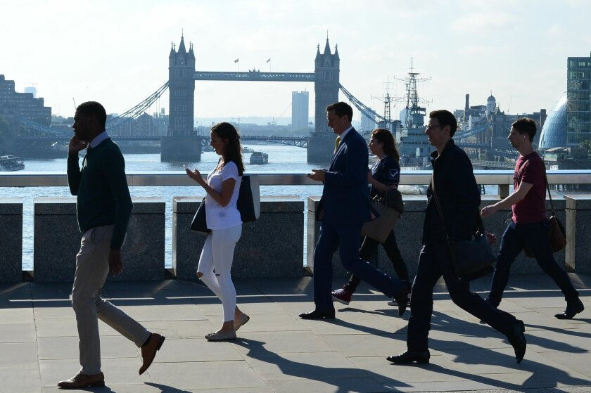 """TOPSHOT - Commuters heading into the City of London cross London Bridge in front of Tower Bridge on June 24, 2016..The Bank of England will take """"all necessary steps"""" to ensure monetary and financial stability after Britain's decision to leave the European Union, it said on June 24. The pound colla"""