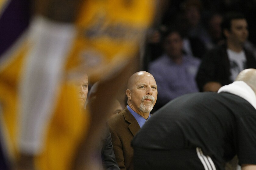 Lakers trainer Gary Vitti sit on the bench during a game against the Toronto Raptors on March 8, 2013.