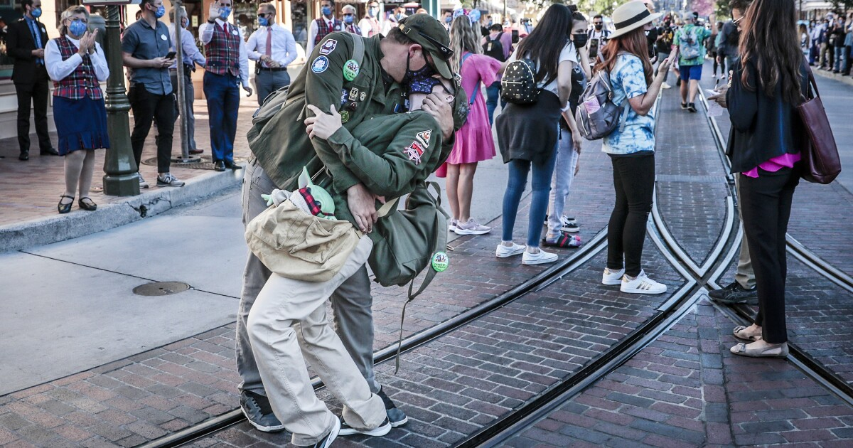 Disneyland reopens: 'This is a homecoming for us,' says a parkgoer in tears