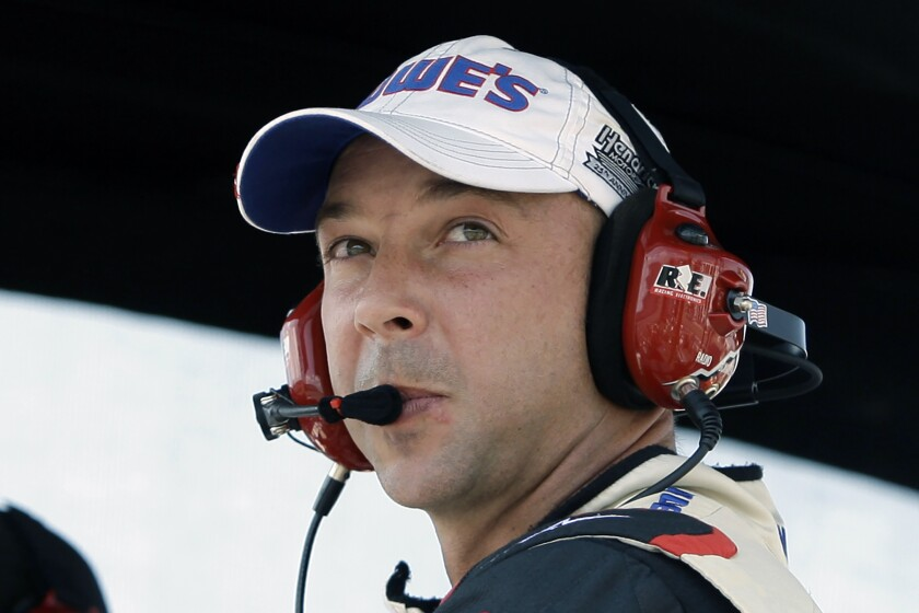 FILE - In this Monday, Aug. 3, 2009, file photo, Chad Knaus, crew chief for driver Jimmie Johnson, looks out over the track from their pit during the NASCAR Pennsylvania 500 auto race at Pocono Raceway in Long Pond, Pa. Chad Knaus will move off the pit stand and into a management role with Hendrick Motorsports, ending his crew chief career after seven championships. Hendrick on Tuesday, Sept. 29, 2020, announced Knaus will move to vice president of competition. (AP Photo/Carolyn Kaster, File)