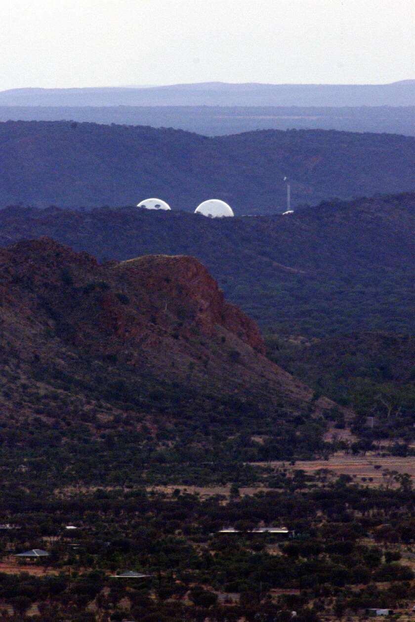 The radar domes of the joint U.S.-–Australian missile defense base at Pine Gap near Alice Springs in central Australia, in a 1999 image.