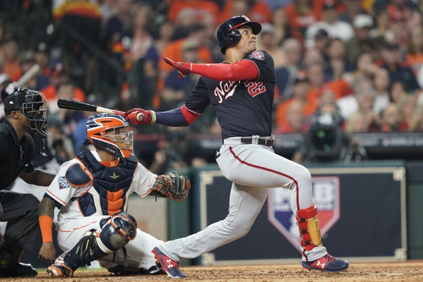 Washington Nationals' Juan Soto hits a solo home run off Houston Astros' Gerrit Cole during Game 1 of the World Series on Oct. 22.