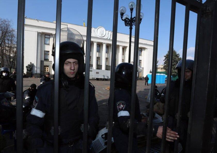 Ukrainian police protect the parliament building in Kiev.