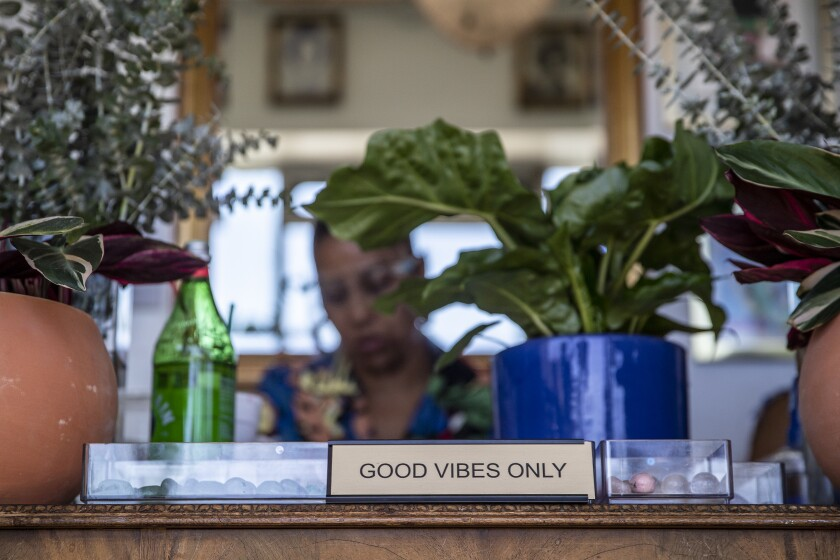 """A """"Good Vibes Only"""" sign is on display at Queen boutique."""