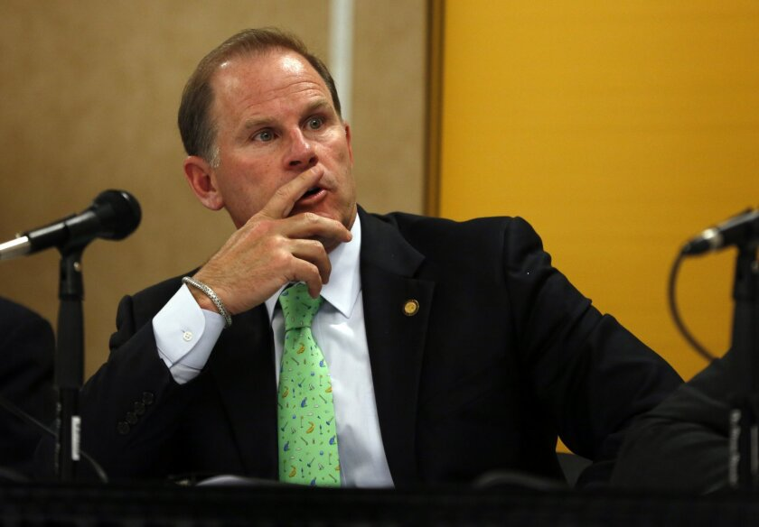 FILE - In this Friday, April 11, 2014, file photo, University of Missouri President Tim Wolfe participates in a news conference in Rolla, Mo. Missouri football players announced Saturday, Nov. 7, 2015, on Twitter that they will not participate in team activities until the university president is re