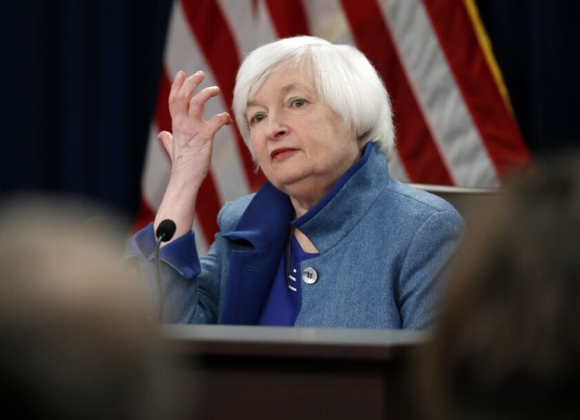 Federal Reserve Chair Janet Yellen listens to a reporter's question during a news conference in December.