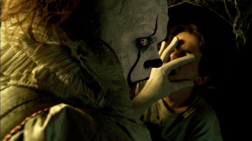 """Bill Skarsgard as Pennywise and Jack Grazer as Eddie Kaspbrak in """"It."""""""