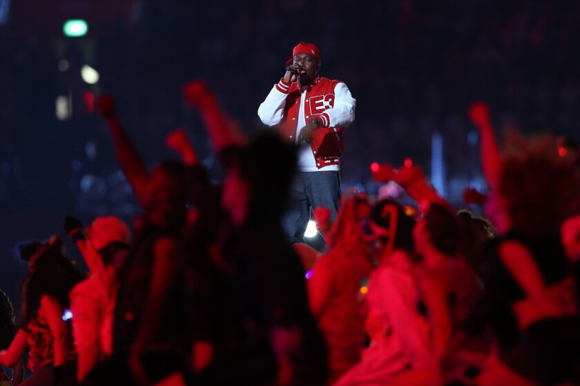 Rapper Dizzee Rascal performs at the Olympics opening ceremony.