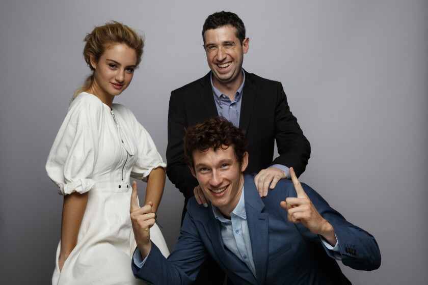 """Actress Grace Van Patten, director Adam Leon, standing, and actor Callum Turner, from the film """"Tramps, in the L.A. Times photo studio at the 41st Toronto International Film Festival."""