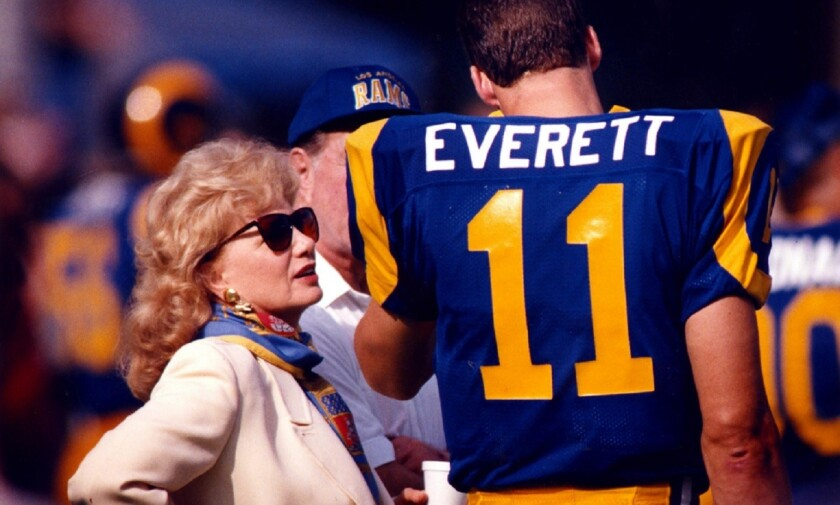 Rams owner Georgia Frontiere talks with quarterback Jim Everett at Anaheim Stadium in a game against the Chiefs on Nov. 10, 2001. Frontiere was booed as she came onto the field.
