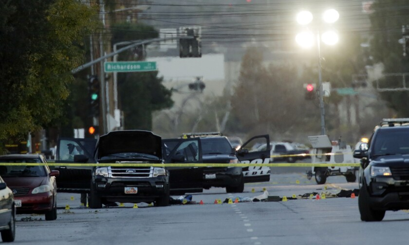 The investigation continues Thursday morning on San Bernardino Avenue, where two suspects in the mass shooting at the Inland Regional Center died in a shootout with police.