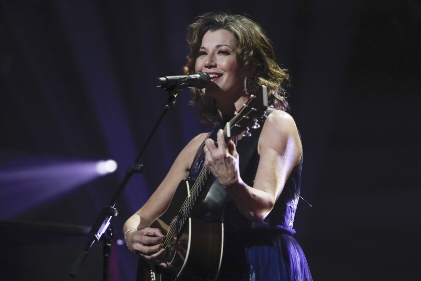 "FILE - In this Oct. 15, 2019 file photo, singer Amy Grant performs during the Dove Awards in Nashville, Tenn. Grant has had open heart surgery to fix a heart condition she has had since birth. A publicist for the singer said doctors discovered the condition during a routine checkup. Grant is married to country singer Vince Gill and is a six-time Grammy winner with hits like ""Baby, Baby,"" and ""That's What Love is For."" (AP Photo/Mark Humphrey, File)"