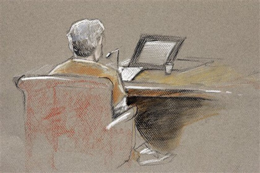 In this courtroom sketch by Matt Sell, Elaine Brown sits in U.S. District Court in Concord, N.H., Friday, Oct. 2,2009. Brown was sentenced to 35 years in federal prison for amassing an arsenal of weapons at her fortress-like home after she and her husband were convicted of tax evasion. (AP Photo/Matt Sell)