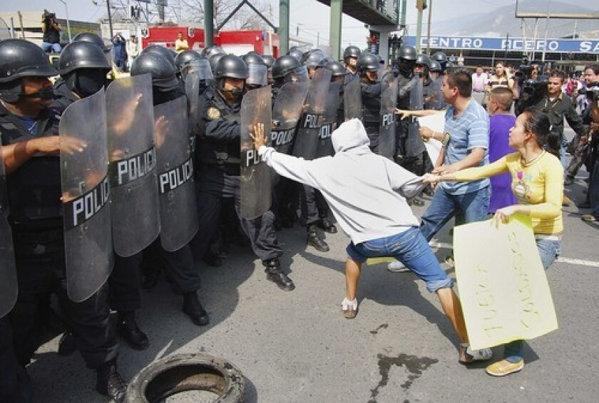 Protesters in the northern Mexican city of Monterrey taunt riot police during a demonstration in February, one of a number in Mexico demanding the departure of soldiers deployed to deal with drug violence.