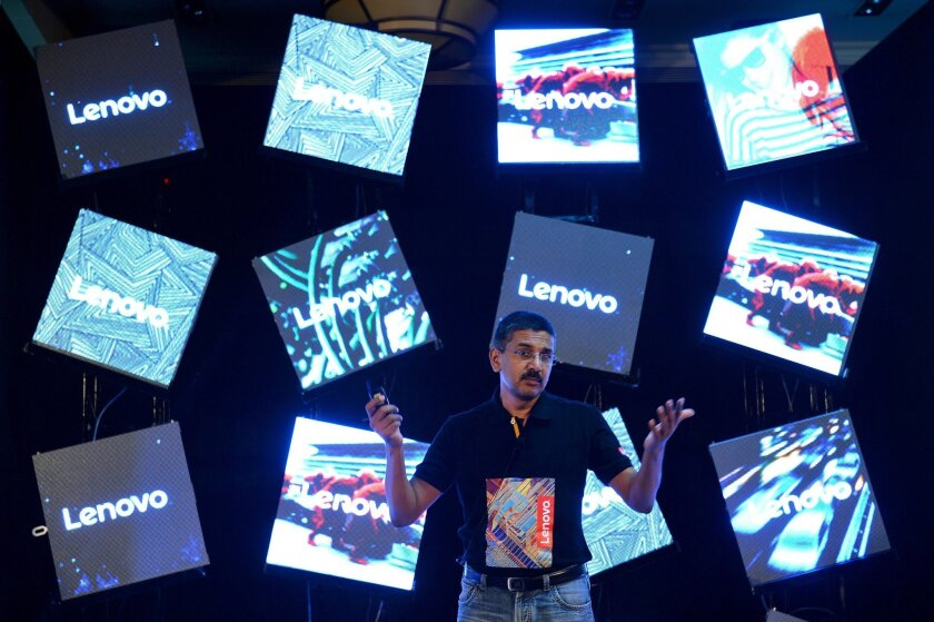 """Lenovo India director of sales Ashok Nair discusses Lenovo's line of flexible """"Yoga"""" laptops at its launch in Bangalore, India, on June 9."""