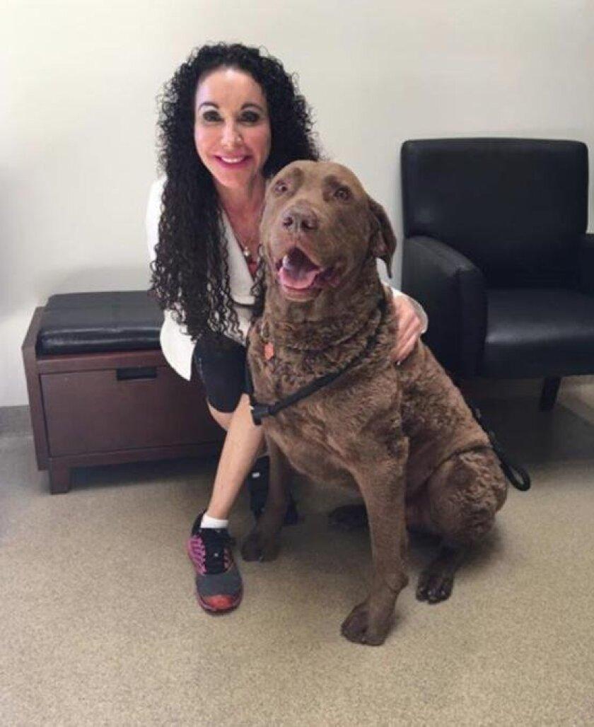 Veterinarian Sue Morizi with Brady Kellogg