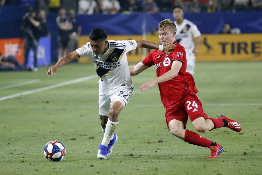 Galaxy defender Julian Araujo, left, is hoping to make a impact on the U.S. men's national team in the years ahead.