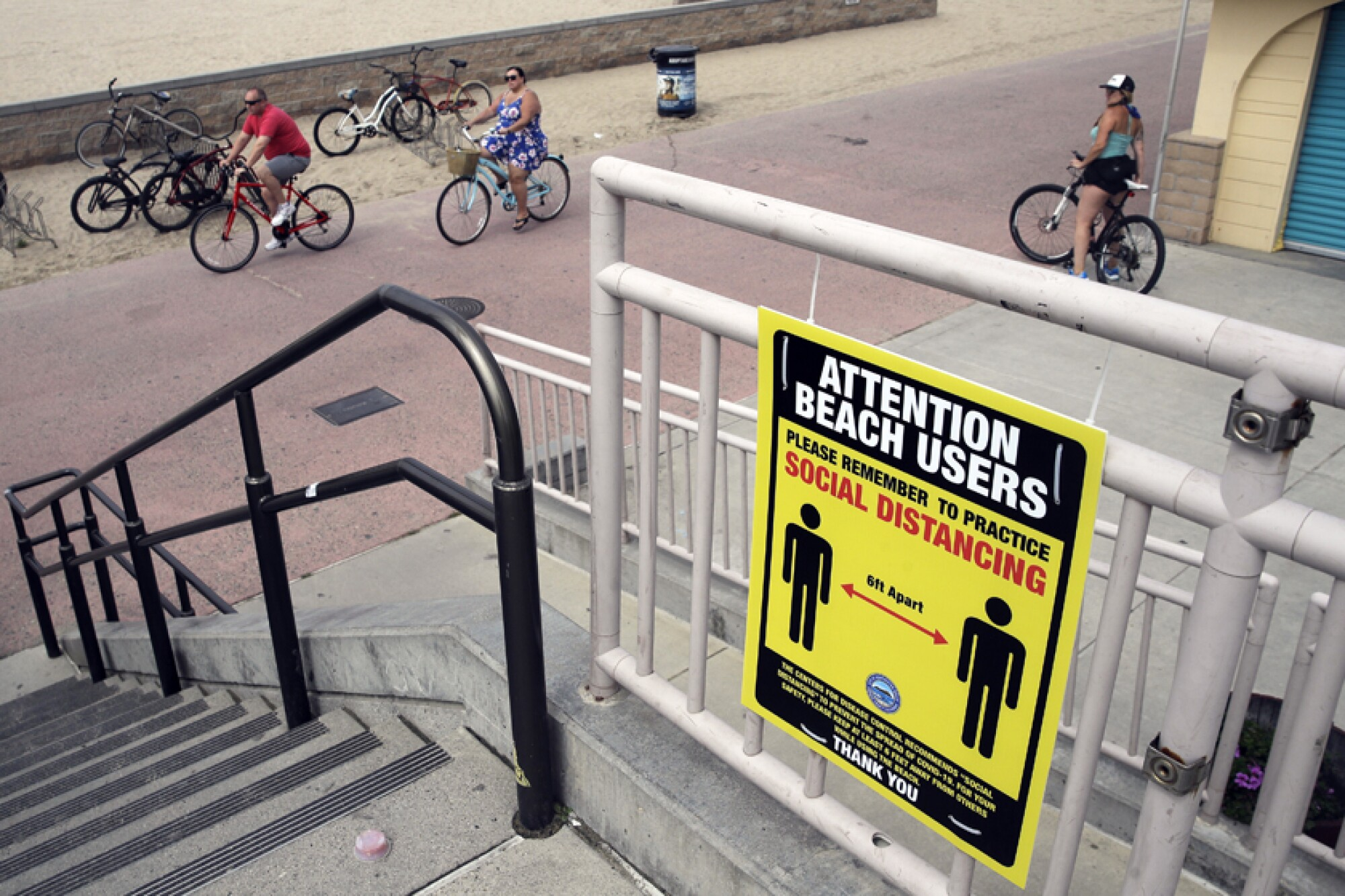 A sign in Huntington Beach encourages people to practice social distancing.
