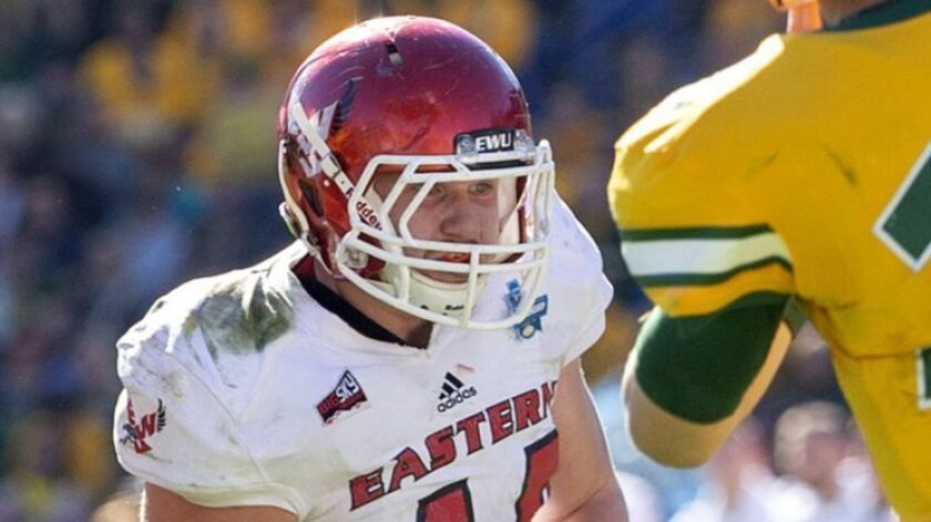 North Dakota State quarterback Easton Stick (12) throws a pass in front of the rush of Eastern Washi