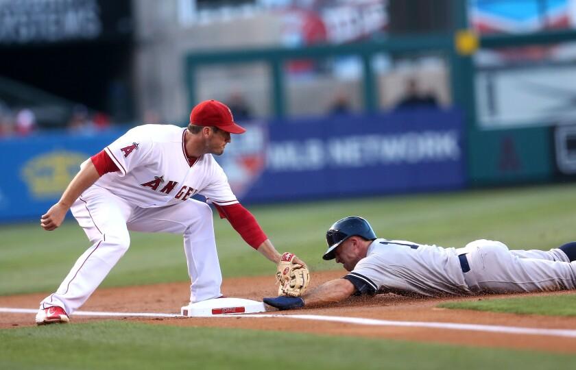 Angels third baseman David Freese tags out Yankees baserunner Brett Gardner during a game in June 2015.