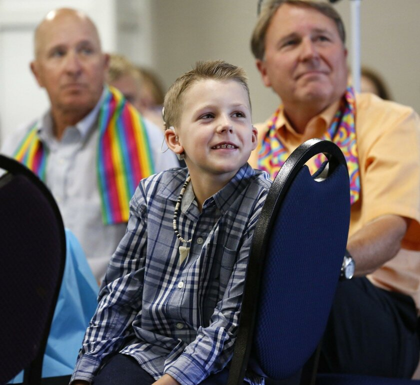 2477868_sd_me_ryland_event_NL Sunday, August 21, 2016 San Diego, CA Photo by Nancee E. Lewis / Nancee Lewis Photography Ryland Whittington, 8, a transgender child, listens as his mom, Hillary Whittington, talked about their family's difficult and sometimes painful journey during a presentation book signing and complementary brunch at Foothills United Methodist Church in La Mesa. In the background are Ryland's, grandfathers Rand Whittington (left) and Tim Hodges, © Nancee E. Lewis / Nancee Lewis Photography. No other reproduction allow with out consent of licensor. Permission for advertising reproduction required.