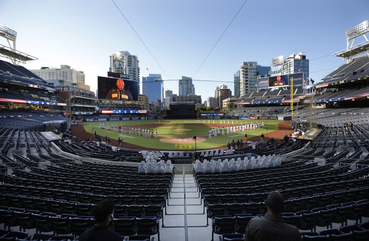 The Padres and Diamondback line the bases for the national anthem on opening day at Petco Park.