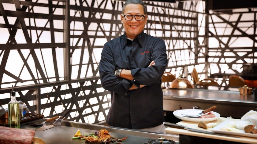 Iron Chef Masaharu Morimoto pauses beside one of three teppan tables at his new Las Vegas restaurant. Inside the MGM Grand, it's the first of Morimoto's 14 restaurants to offer Japanese-style tableside cooking.