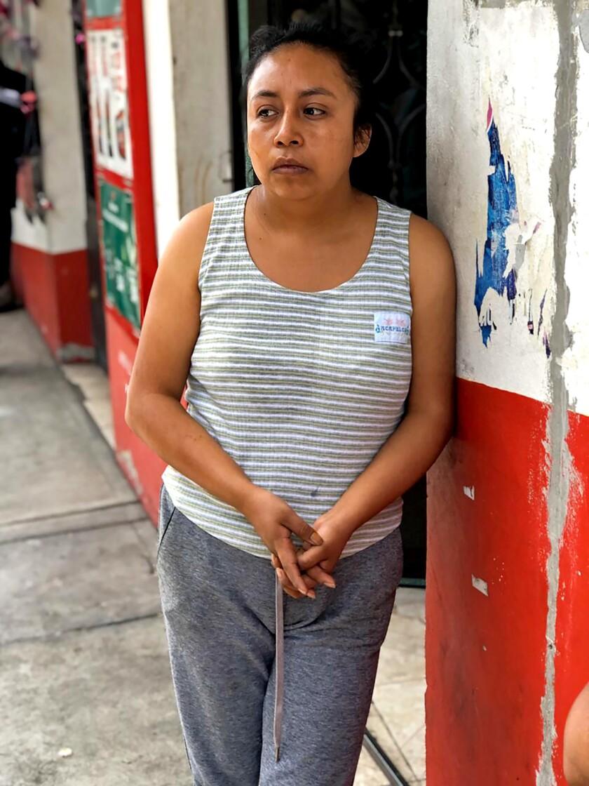 Saida Rojas, 26, daughter of Jose Felix Rosas, outside their home in La Magdalena de Axocopan