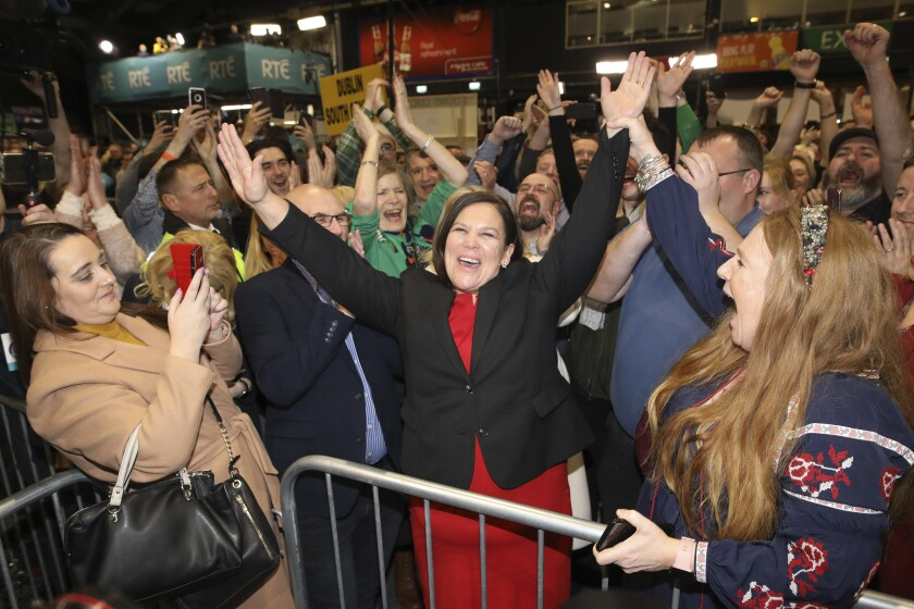 Sinn Fein leader Mary Lou McDonald, center, and supporters celebrate election results in Dublin on Sunday.