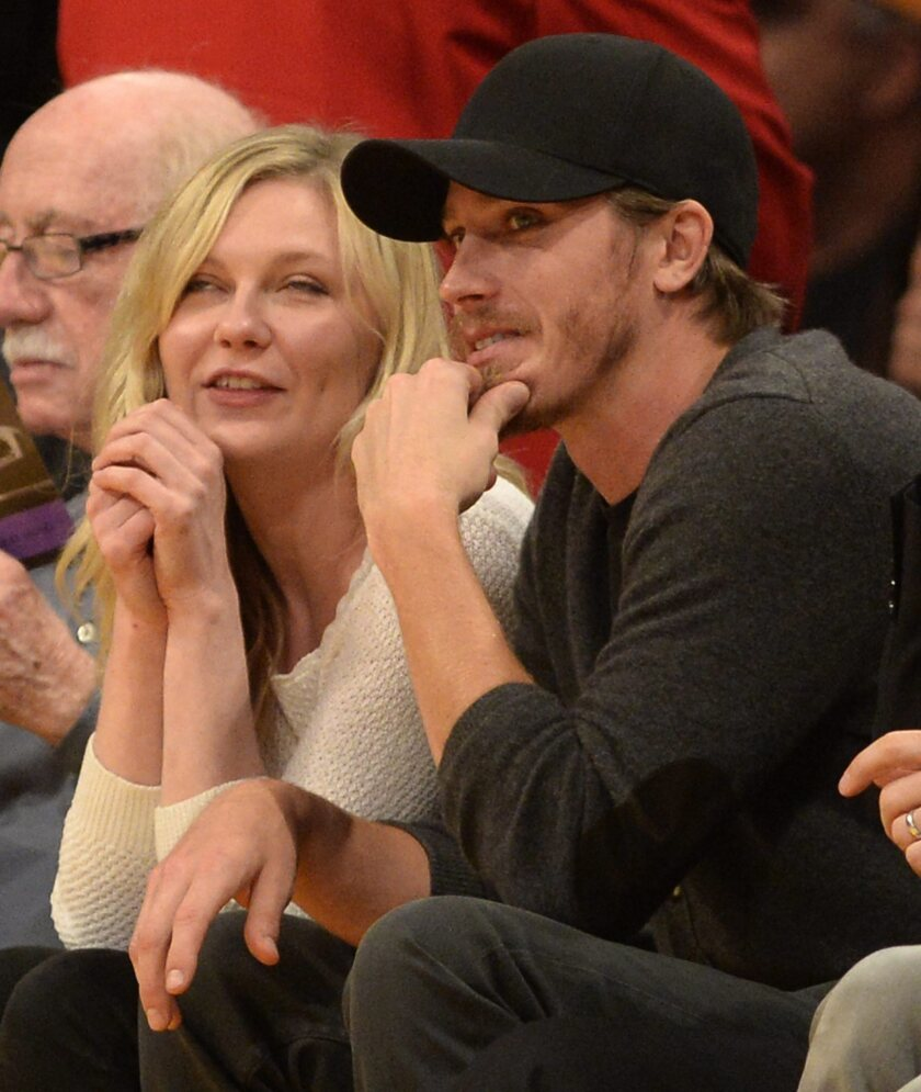 Kirsten Dunst is seen at a Lakers game with actor Garrett Hedlund at Staples Center.
