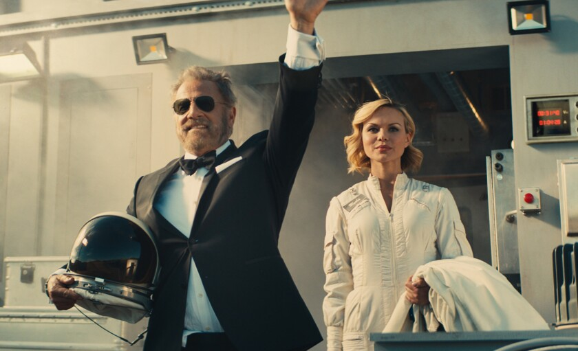 The Most Interesting Man in the World, played by Jonathan Goldsmith, waves goodbye to Earth.
