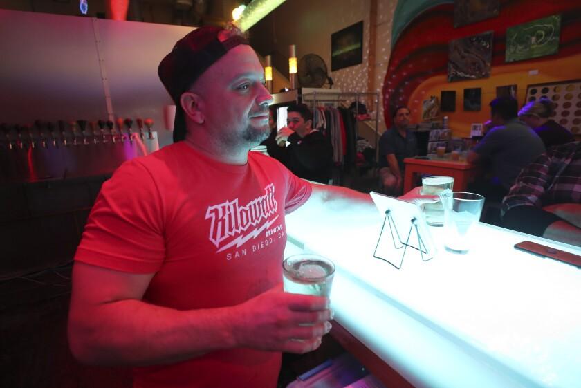 Server Mike Guardabascio serves Ziely Pineapple Hard Seltzer at Kilowatt Brewing on Tuesday, November 19, 2019 in San Diego.