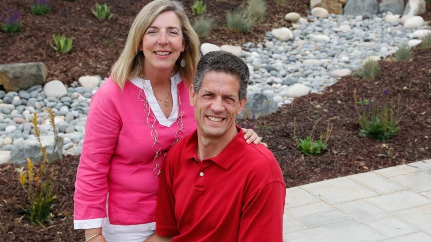 Andrea and Bob Raibert in their Poway front yard.