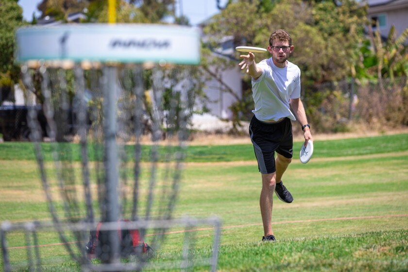 Thomas Gilbert from Toronto practices putting in preparation for this weekend's pro disc golf tournament