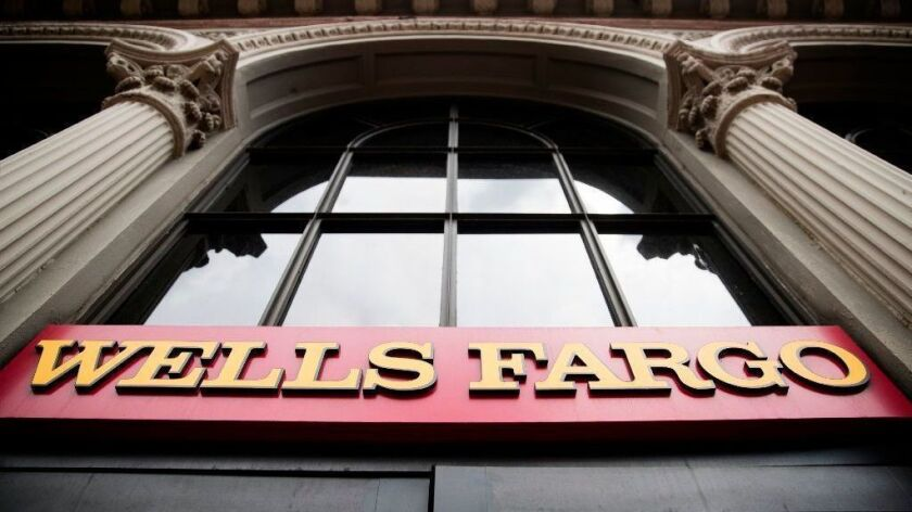Wells Fargo & Co. will probably remain under a Federal Reserve enforcement action into early next year, the bank's CEO said Thursday.