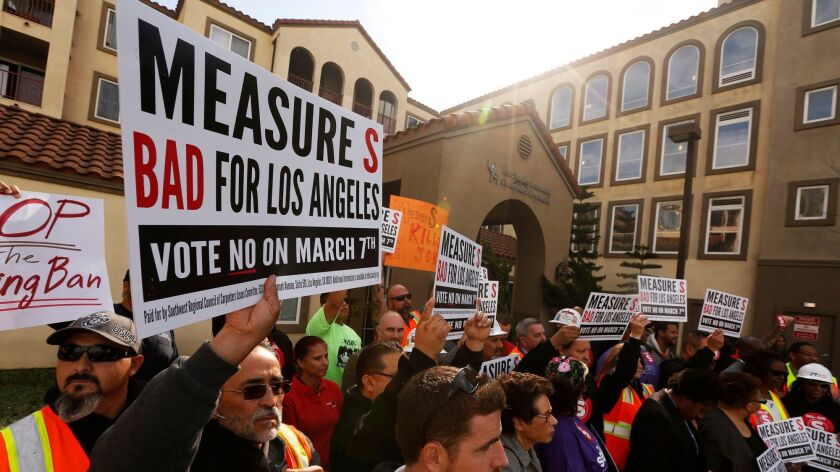 Workers with the Southwest Regional Council of Carpenters at an anti-Measure S news conference in February.