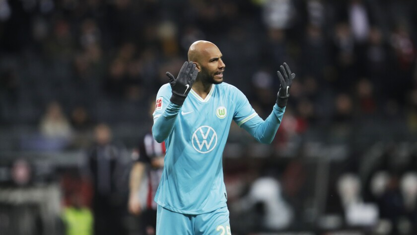 Wolfsburg's player John Brooks from the United States, gestures during the German Bundesliga soccer match between Eintracht Frankfurt and VfL Wolfsburg in the Commerzbank Arena Frankfurt, Germany In this Saturday, Nov. 23, 2019. Wolfsburg is benefitting from American input after making a club-record 10-game unbeaten start to the Bundesliga. (AP Photo/Michael Probst)